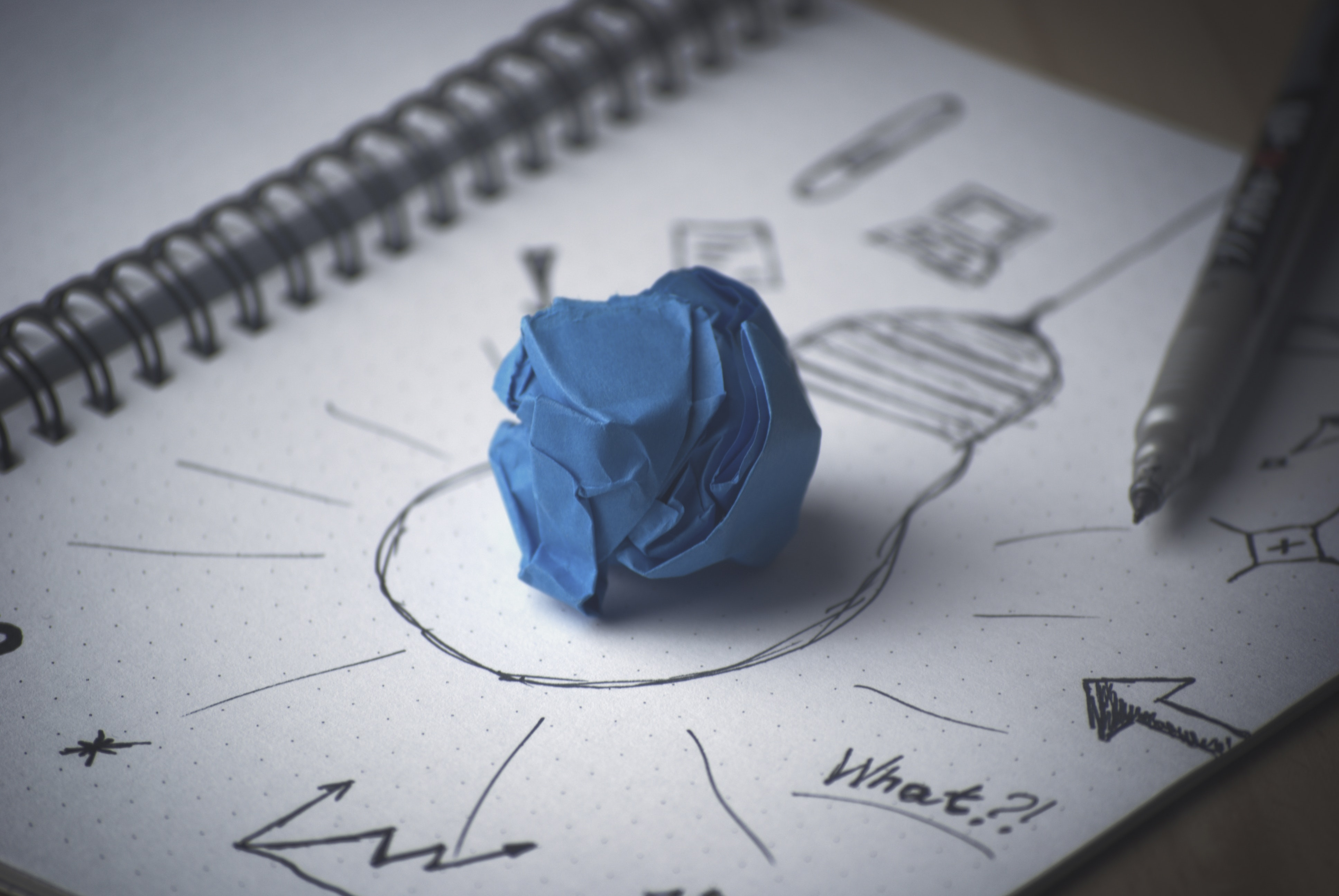 innovation pen-idea-bulb-paper
